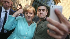 Merkel Visits Migrants' Shelter And School